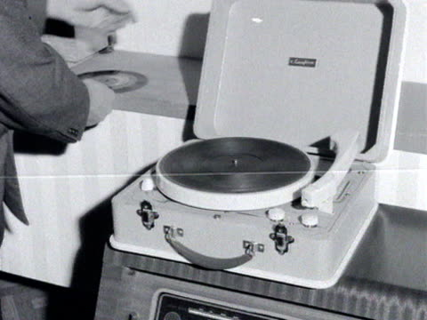 man demonstrates a new portable record player. - portability stock videos & royalty-free footage