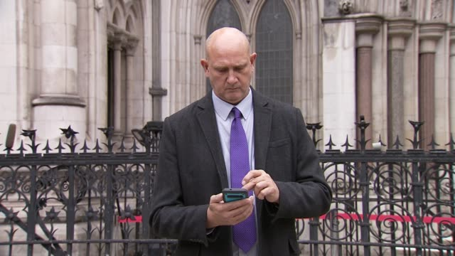 man denied multimillion pound payout by betfred takes fight to high court england london ext various of andrew green using phone outside the royal... - itv evening news stock videos & royalty-free footage
