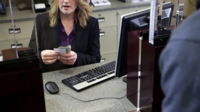 man depositing cash in bank - counting stock videos & royalty-free footage