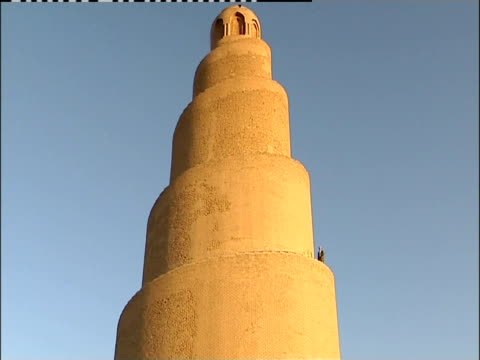 a man descends the final spiral on the malwiya minaret. - spiral stock videos & royalty-free footage