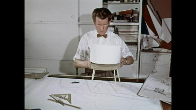 MONTAGE Man designing chair / United Kingdom