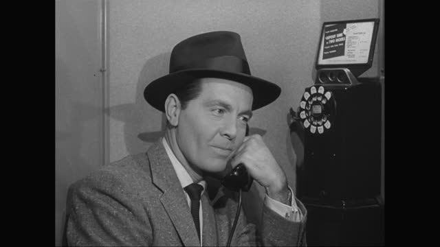 MS Man dialling number and talking on telephone / United States