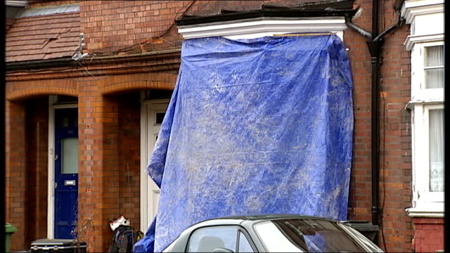 Man dies in fire in his flat in south London ENGLAND London Streatham EXT Blue tarpaulin over outside of flat where man died in a fire