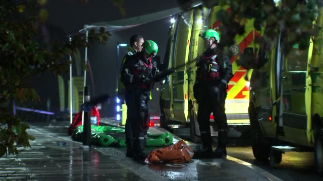 man dies in the river lea in tottenham after being chased by police officers; england: north london: tottenham: ext / night emergency service... - itv london lunchtime news stock videos & royalty-free footage