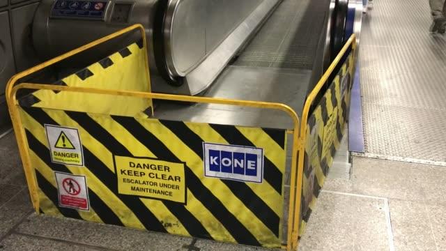 man dies while working on travelator at waterloo station; england: london: waterloo station: int various shots of barrier blocking entrance to... - ランベス点の映像素材/bロール