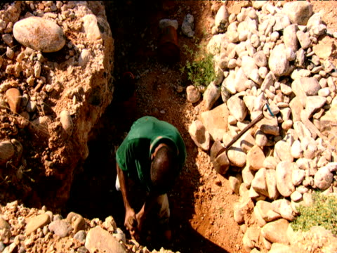 man digging with pick axe in surface mine diamond mining in south africa - precious gem stock videos & royalty-free footage