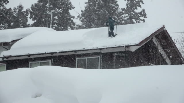 Man digs out after blizzard dumps huge amount of snow on village in northern Japan