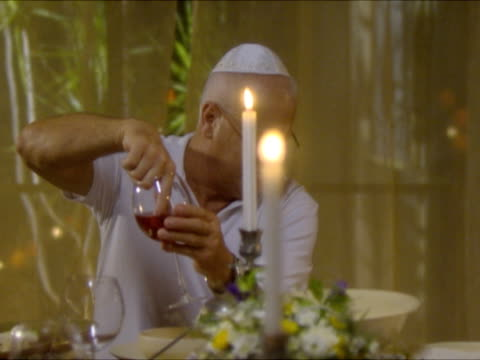 ms man dipping his finger in wine at seder night during passover dinner and ceremony / beit yitzhak, israel - passover stock videos and b-roll footage