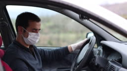 man disinfects his car