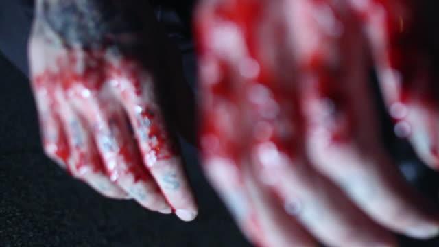 CU R/F Man displays bloodied knuckles / Jacksonville Beach, Florida, United States