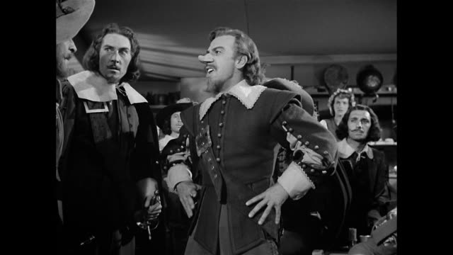 a man (william prince) displays courage through puns at the expense of cyrano de bergerac (josé ferrer) - storytelling stock videos and b-roll footage