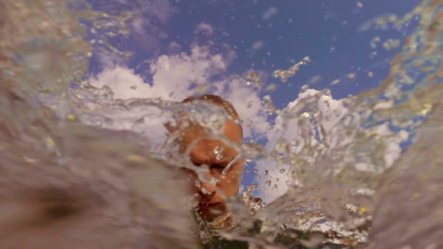 man dive and play in the water - standing water stock videos and b-roll footage