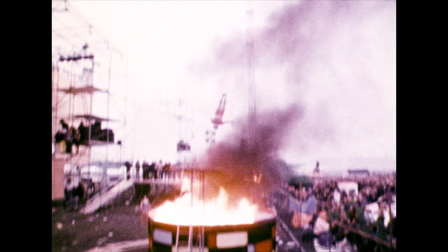 man dives into a flaming pool at festival; 1972 - stunt stock videos & royalty-free footage