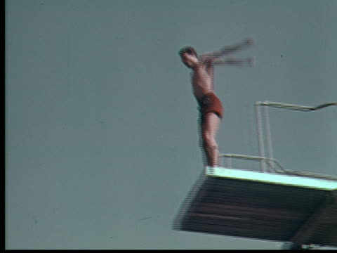 1955 la ws td man diving into pool from high dive / usa - diving platform stock videos and b-roll footage