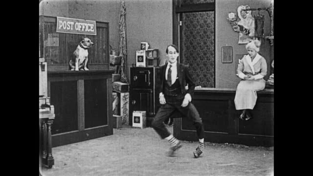 1919 man does silly dance in country store - silent film stock videos & royalty-free footage