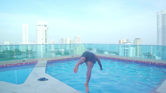 man doing a dive in the pool - colombian ethnicity stock videos & royalty-free footage