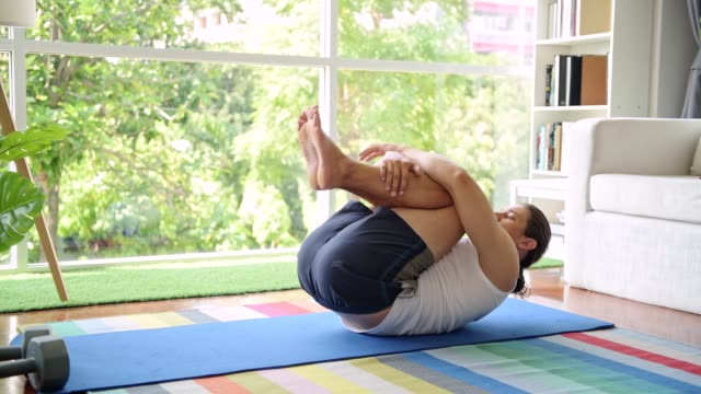man doing a roll up stretching. - exercise room stock videos & royalty-free footage