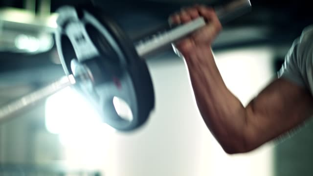 man doing barbell exercise in the gym - exercise equipment stock videos & royalty-free footage