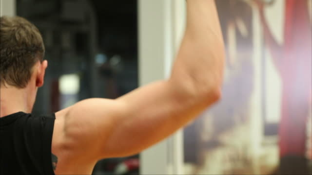man doing body building exercise at gym - human limb stock videos & royalty-free footage