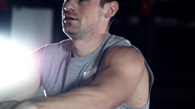 man doing cardio workout on rowing machine - rowing machine stock videos & royalty-free footage