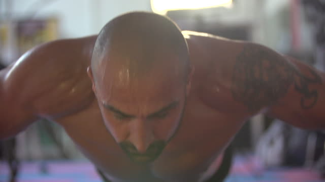 Man doing clapping push-ups and gym workout at the gym.  - Slow Motion - 1920x1080 - filmed at 200 fps