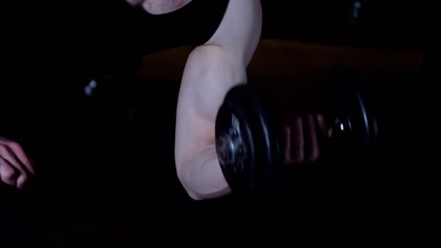 man doing concentration curls exercise working out with dumbbell - arm curl stock videos & royalty-free footage