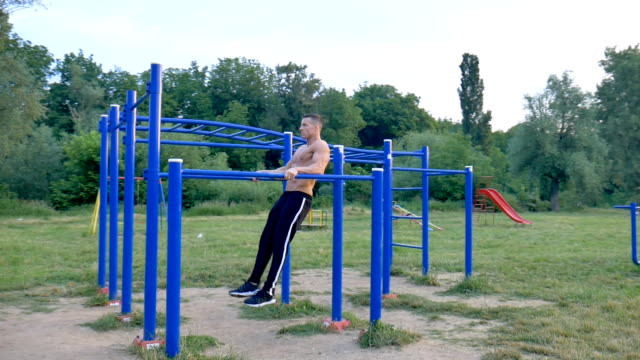 man doing dip exercise in the local park - pectoral muscle stock videos and b-roll footage