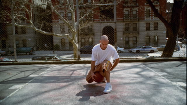 ws man doing dribbling tricks with basketball on morningside park basketball court/ harlem, new york  - 30 seconds or greater stock videos & royalty-free footage