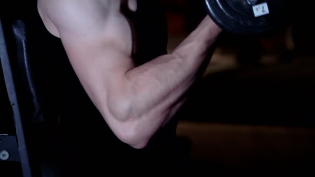 man doing exercise working out with dumbbell - arm curl stock videos & royalty-free footage