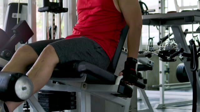 man doing exercises in gym. - leg press stock videos & royalty-free footage