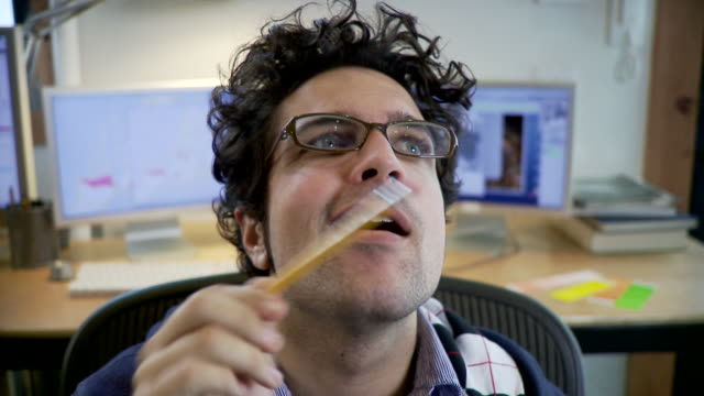 cu, man doing faces playing with pencil in office, brooklyn, new york city, new york state, usa - bleistift stock-videos und b-roll-filmmaterial