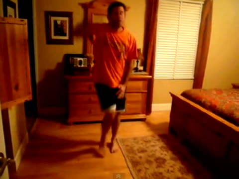 vidéos et rushes de / man doing funny dance to vanilla ice song / man slips on floor and hurts his foot and them jumps onto bed. man doing embarrassing dance on april... - dancing