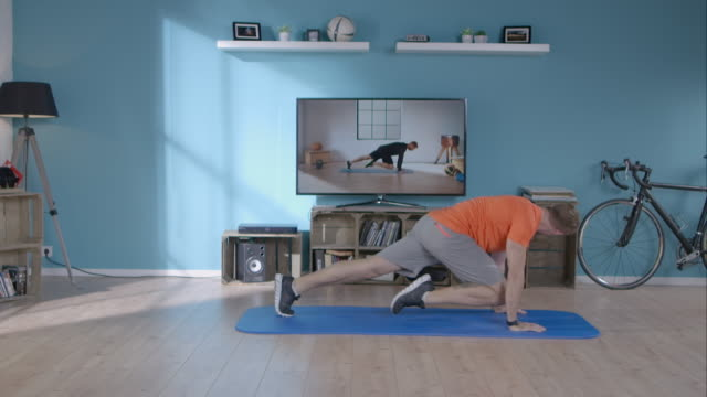 man doing his workout at home - exercising stock videos & royalty-free footage