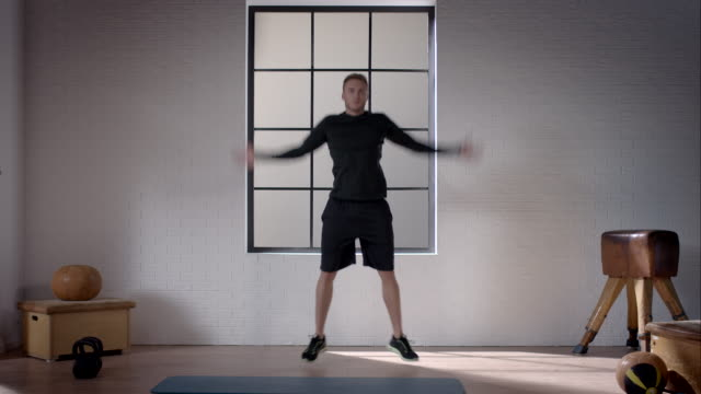 man doing his workout in gym (jumping jacks) - star jump stock videos & royalty-free footage