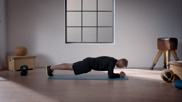 man doing his workout in gym (plank) - plank stock videos & royalty-free footage