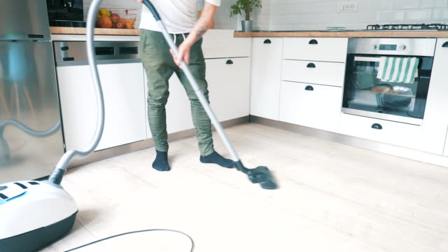 man doing house cleaning. - housework stock videos & royalty-free footage