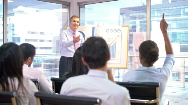 man doing in a business presentation at the office - punto interrogativo video stock e b–roll