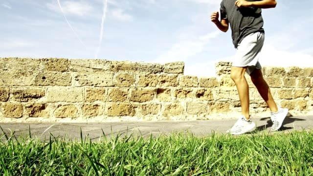 man doing jogging outdoor - human leg stock videos & royalty-free footage