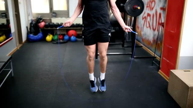 Man doing jump roap work out
