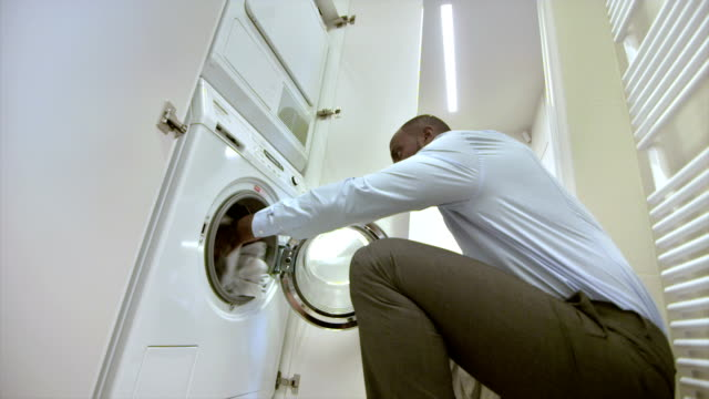 ms man doing laundry - washing stock videos & royalty-free footage
