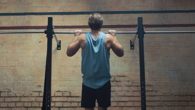 man doing pull-ups in gym - horizontal bar stock videos & royalty-free footage