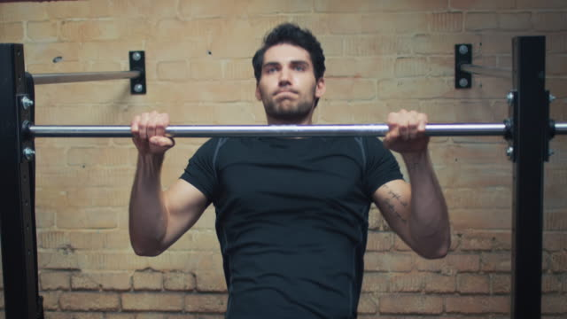 man doing pull-ups in gym - pull ups stock videos & royalty-free footage