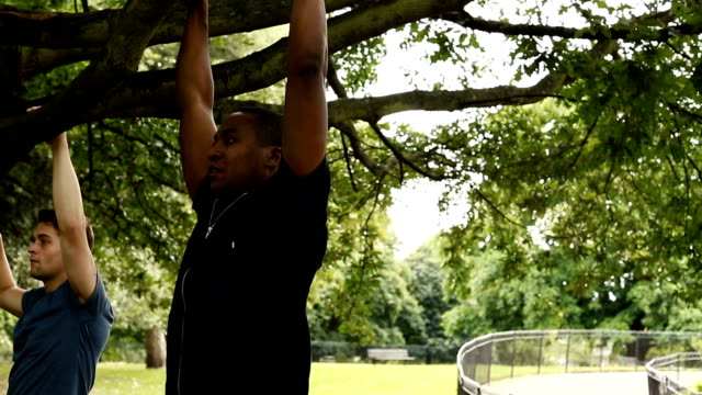man doing pull-ups - pull ups stock videos & royalty-free footage