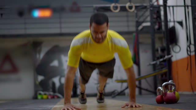 Man doing push ups and clapping in the air