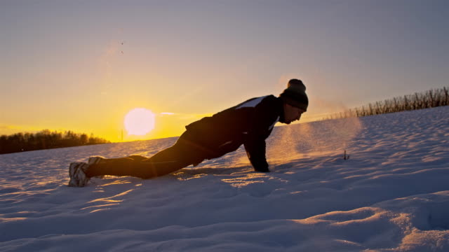 SLO MO Man Doing Push Ups In The Snow