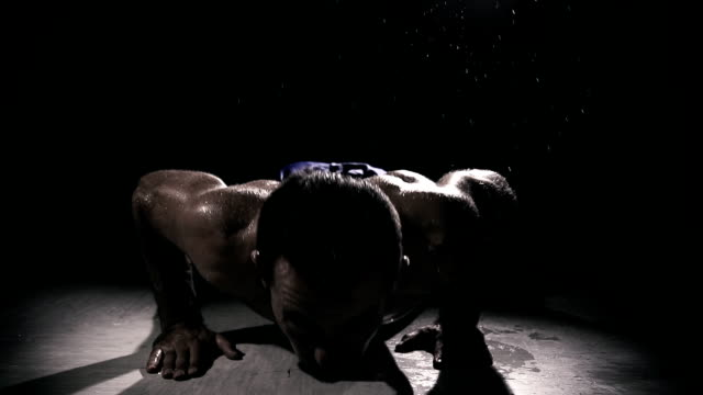 hd super slow mo: man doing push ups - washboard stock videos and b-roll footage
