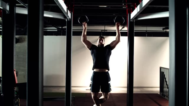 man doing ring pull-ups in the gym - gymnastic rings stock videos & royalty-free footage