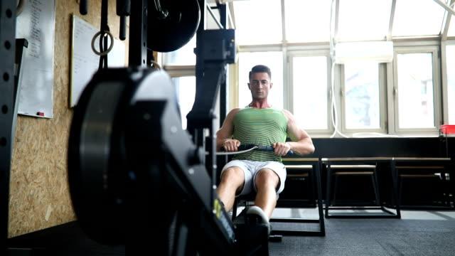 man doing rowing machine workout - rowing machine stock videos & royalty-free footage