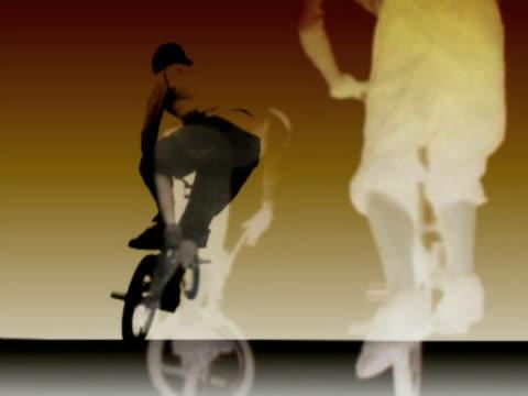 Man doing stunts on BMX bicycle