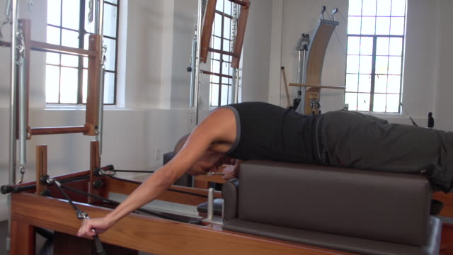 """""""ms man doing workout on pilates reformer / beverly hills, california, united states"""" - only mature men stock videos & royalty-free footage"""